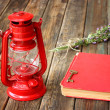 Vintage red lantern and red book on wooden table — Stock Photo
