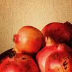 Pomegranates on canvas background — Stock Photo #29294455