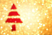 Christmas tree with defocused lights. golden background — Stock Photo