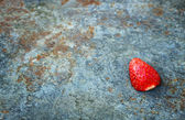 Textured grunge background with strawberry — Stock Photo