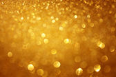 Golden christmas background or gold defoucsed lights background — Stock Photo