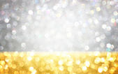Gold and silver defocused glitter lights background. abstract bokeh. — Stock Photo