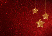 赤の背景にボケ味ライト、きらめく星をデフォーカス — ストック写真