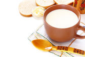Jug with milk and bread isolated on white background — Stock Photo