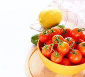 Tomatoes and lemon isolated on white background — Stock Photo