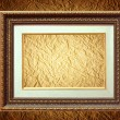 Golden frame over grunge wallpaper — Stock Photo #29367313