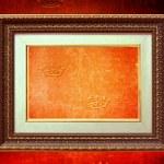 Golden frame over grunge wallpaper — Stock Photo
