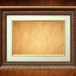 Golden frame over grunge wallpaper — Stock Photo #29372885