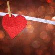 Red glitter heart hang over brown bokeh background — Stock Photo