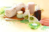 Spa and wellness setting with natural soap, candles and towel — Stock Photo