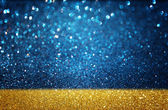 Gold and blue fefocused lights background — Stock Photo