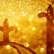 Stock Photo: Fence spears and glitter gold light burst