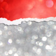 Silver bokeh lights and red torn paper — Stock Photo #32024055
