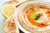 Hummus dip plate and lemon — Stock Photo