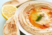 Hummus dip plate and lemon — Stock Photo