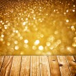 Textured wood planks and warm golden bokeh lights effect — Stock Photo #35959073