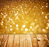 Textured wood planks and warm golden bokeh lights effect — Stock Photo