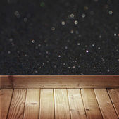 Black glitter lights and wooden floor planks — Stock Photo