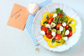 Salad with mozzarella and fresh vegetables — Stock Photo