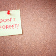 Dont forget or do not forget reminder, written on Yellow Sticker on Cork Bulletin or Message Board. — Stock Photo