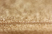 Abstract golden glitter lights and bokeh background — Stock Photo