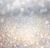 White and silver abstract bokeh lights. defocused background — Foto Stock