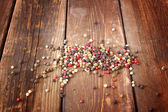 Pepper spice on wood table — Stock Photo