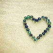 Marbles in heart shape — Stock Photo