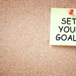 Stock Photo: Set your goals concept. sticky pinned to corkboard with room for text.