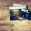 Top view of old vintage camera and pictures over wooden brown background. — Stock Photo #40855207