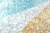 Glitter burst of defocused lights, gold white and blue — Stock Photo