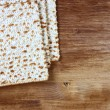 Passover background. wine and matzoh (jewish passover bread) over wooden background. — Stock Photo #40947707