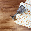 Passover background. wine and matzoh (jewish passover bread) over wooden background. — Stock Photo #40947739