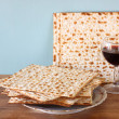 Stock Photo: Passover background. wine and matzoh (jewish passover bread) over wooden background.