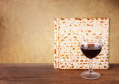 Passover background. wine and matzoh (jewish passover bread) over wooden background. vintage effect process. — Stock Photo