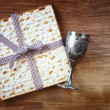 Passover background. wine and matzoh (jewish passover bread) over wooden background. — Stock Photo #41347773