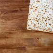 Passover background. wine and matzoh (jewish passover bread) over wooden background. — Stock Photo #41347777
