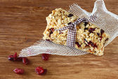 Granola bar or energy bar on wooden background — Stok fotoğraf
