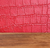 Red leather with square background with wooden table board — Foto de Stock