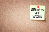 Sticky pinned to corkboard with the phrase genius at work. room for text. — Stock Photo