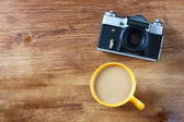 Top view of old camera cup of coffee and book — Foto Stock