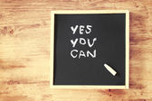 Phrase yes you can on board — Foto Stock