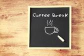 Board with the phrase coffee break — Stock Photo
