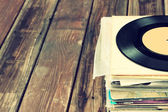 Records stack and old record — Stock Photo