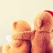 Two teddy bears on a shelf — Stock Photo #44116175