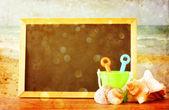 Blackboard over beach — Stock Photo