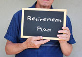 Senior man holding blackboard with the phrase pension plan written on it — Stock Photo