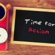 Clock, coffee cup and blackboard with the phrase time for change — Stock Photo