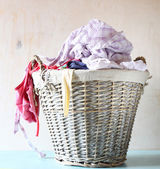 Laundry basket full with clothes — Stockfoto