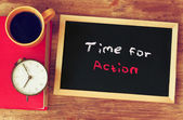 Clock, coffee cup and blackboard with the phrase time for change — Stok fotoğraf